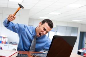 angry man smashing his laptop